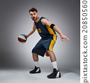 Full length portrait of a basketball player with 20850560