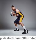 Full length portrait of a basketball player posing 20850562