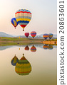 Hot air color balloon over lake with sunset time 20863601