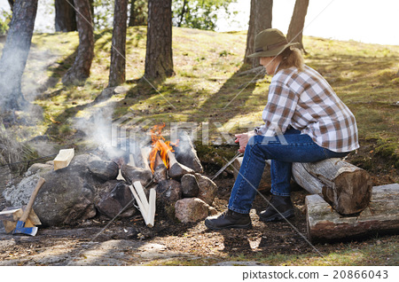 Lighting the camp fire 20866043