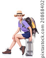 Woman traveler sitting on suitcase with backpack  20868402