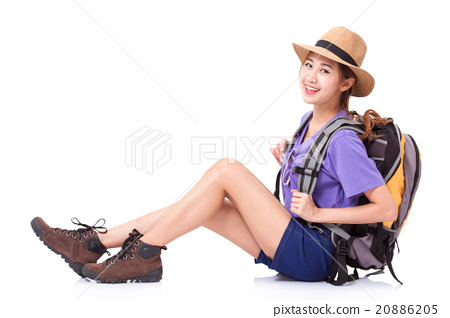 Woman traveler sitting on the floor with backpack 20886205