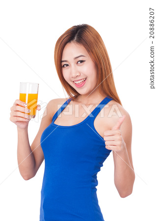 Portrait of young woman drinking orange juice 20886207