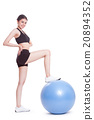 Young woman doing exercises with fitness ball. 20894352