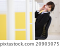 young beautiful  business woman with headset in office 20903075