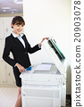pretty young secretary using  photocopy machine in office 20903078