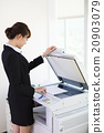 young businesswoman using  photocopy machine in office 20903079