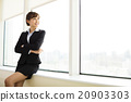 young smiling  businesswoman working in the office 20903303
