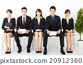 happy business people sitting on the chairs 20912360