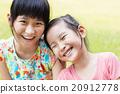 closeup Cute little girls on the grass 20912778