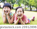 closeup happy little girls on the grass 20912896
