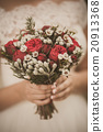 Beautiful floral composition in hands of bride 20913368