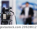 Cameraman recording  press conference 20928612