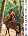 Buddhist monk ride horse 20932826