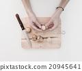 hands peel longkong, langsat on a wooden board 20945641