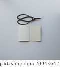 Small opened notebook and Japanese scissors 20945642