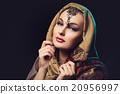 Beautiful young woman in shawl 20956997