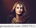 Beautiful young woman in shawl 20957011