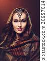 Beautiful young woman in shawl 20957014