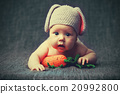 happy baby child in costume a rabbit bunny with carrot on a grey 20992800