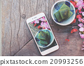 Taking photo of matcha mochi japanese dessert 20993256
