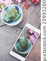 Taking photo of matcha mochi japanese dessert 20993260