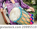 Man drumming 20995510