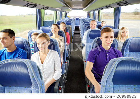 Stock Photo: group of happy passengers in travel bus