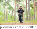 young soldier with backpack in forest 20999015
