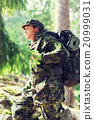 young soldier with backpack in forest 20999031
