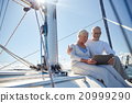senior couple with tablet pc on sail boat or yacht 20999290