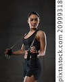 young sporty woman with jumping rope 20999318