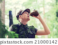 young soldier with gun and flask in forest 21000142