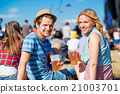 Young couple with beer at summer music festival 21003701