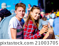 Young couple with beer at summer music festival 21003705