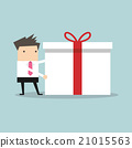 Businessman holding a big gift box for Christmas 21015563