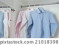 white, blue and pink clean ironed men's shirts 21018398