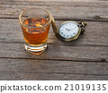 Glass of whisky and Vintage pocket watch 21019135