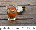 Glass of whisky and Vintage pocket watch  21019137