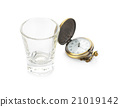 empty wisky glass and vintage pocket watch  21019142