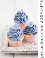 Decorated yellow cupcakes 21041043