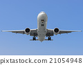 Commercial airplane on finals runway 21054948