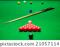 snooker balls set on a green table 21057114