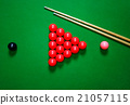 snooker balls set on a green table 21057115
