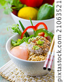 Chinese noodles with minced pork and egg in bowl 21063521