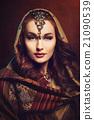 Beautiful young woman in shawl 21090539