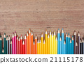 Color pencils on wooden background 21115178