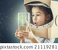 Child is dressed in an astronaut costume 21119281