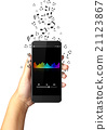 Hand holding smart phone with music notes 21123867