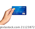 Hand holding plastic credit card Isolated on white 21123872